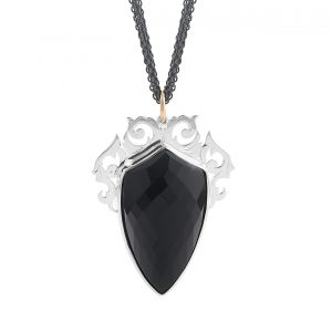Filigree framed faceted onyx crest